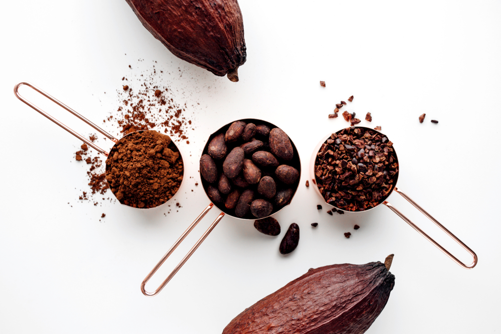 Cocoa - containing the high dose of theobromine, a substance similar to caffeine. That is why you feel better after eating chocolate!