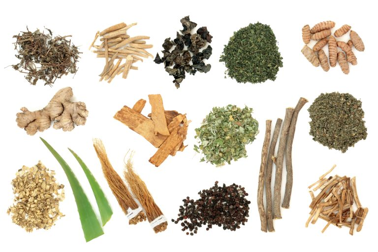 Adaptogen herb and spice selection on white background. Used in herbal medicine to help the body resist the damaging effect of stress and restore normal physiological functioning.