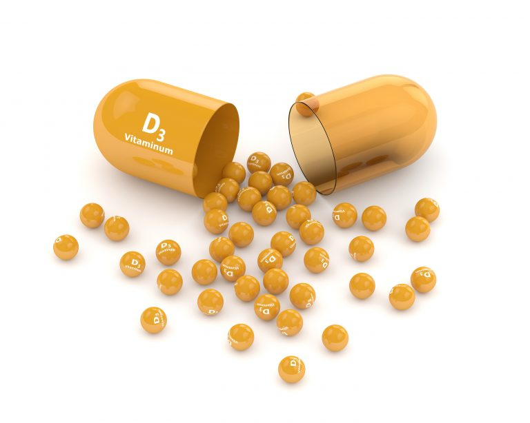 3d render of vitamin d3 pill with granules over white background